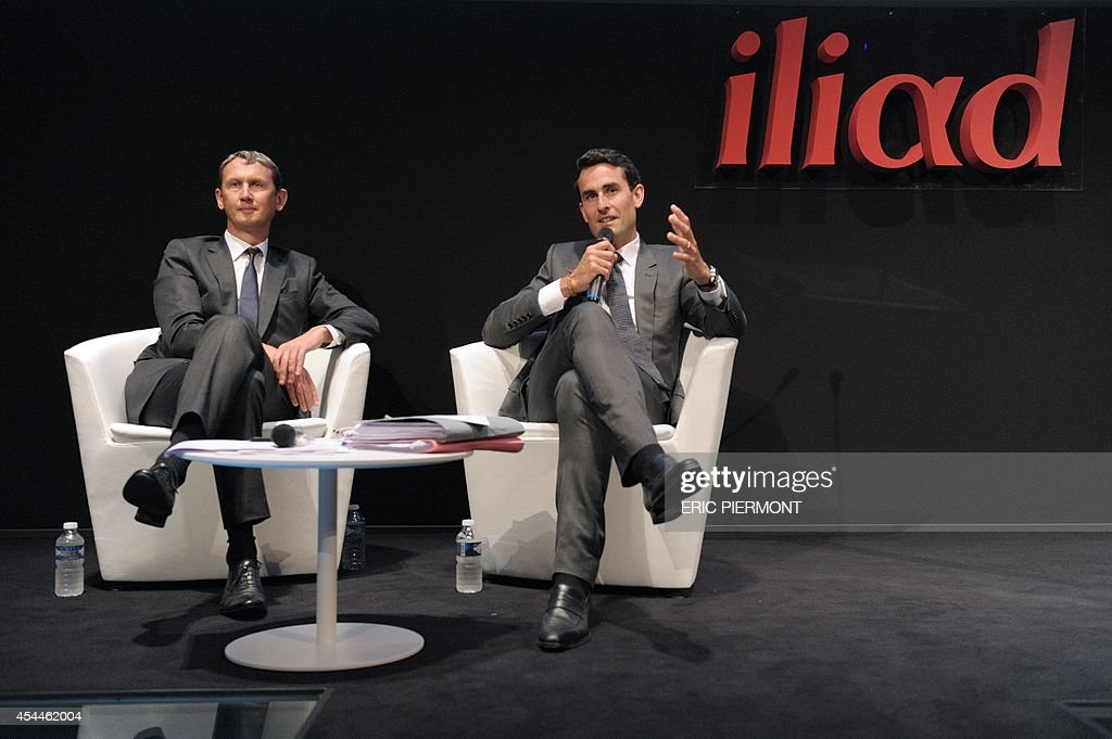 French telecom group Iliad CEO Maxime Lombardini (L) and CFO Thomas Reynaud (R) answer to questions during a press conference next to CFO Thomas Reynaud (L) to present the group's 2014 first half results, in Paris on September 1, 2014