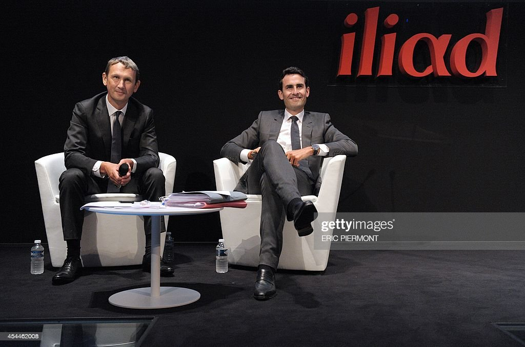 French telecom group Iliad CEO Maxime Lombardini (L) and CFO Thomas Reynaud (R) listen to questions during a press conference next to CFO Thomas Reynaud (L) to present the group's 2014 first half results, in Paris on September 1, 2014 AFP PHOTO ERIC PIERMONT
