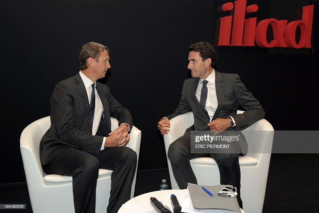 French telecom group Iliad CEO Maxime Lombardini (L) and CFO Thomas Reynaud (R) arrive to give a press conference next to CFO Thomas Reynaud (L) to present the group's 2014 first half results, in Paris on September 1, 2014
