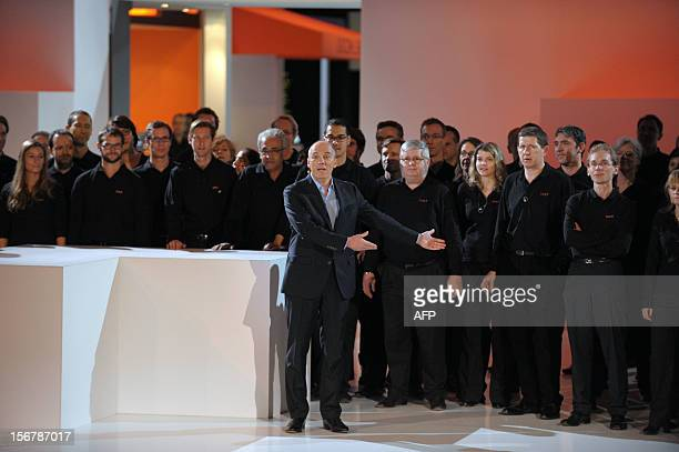 French telecom group OrangeFrance Telecom CEO Stephane Richard welcomes on stage Orange staff members at the end of a press conference to unveil...