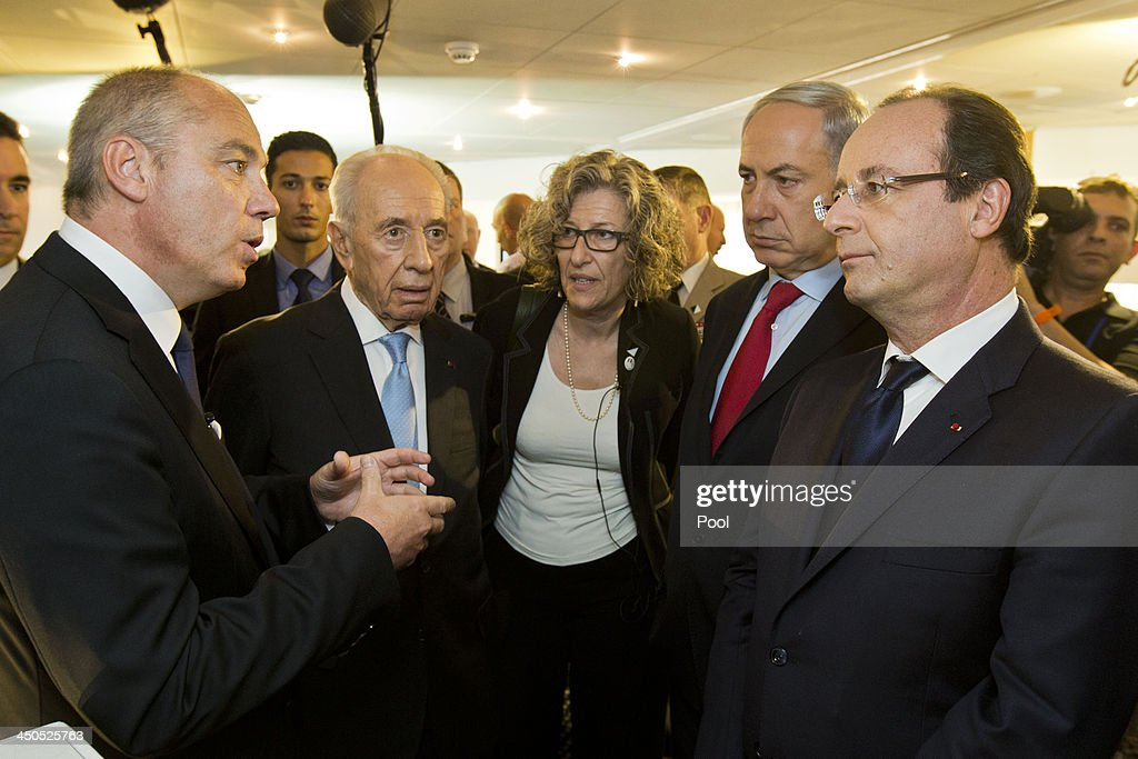 French telecom group Orange's CEO Stephane Richard (L) addresses French President Francois Hollande (R), Israeli Prime Minister <a gi-track='captionPersonalityLinkClicked' href=/galleries/search?phrase=Benjamin+Netanyahu&family=editorial&specificpeople=118594 ng-click='$event.stopPropagation()'>Benjamin Netanyahu</a> (2nd R) and President <a gi-track='captionPersonalityLinkClicked' href=/galleries/search?phrase=Shimon+Peres&family=editorial&specificpeople=201775 ng-click='$event.stopPropagation()'>Shimon Peres</a> (2nd L) during their visit to a French-Israeli technology innovation summit at a hotel on November 19, 2013 in Tel Aviv, Israel. President Hollande was on the final day of his three-day trip to Israel and the Palestinian territories and attended a French-Israeli technology innovation summit and also met French community members.
