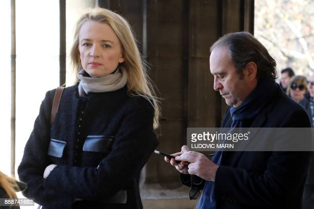 French telecom Iliad Group founder and Vice President Xavier Niel and Director and executive Vice President of Louis Vuitton Delphine Arnault arrive...