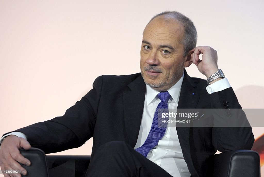 French telecom operator Orange CEO Stephane Richard listens questions after presenting the groups 2014 results in Paris on February 17, 2014. AFP PHOTO / ERIC PIERMONT