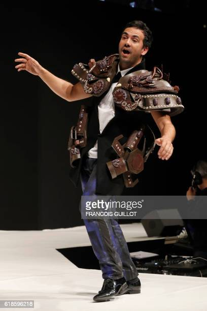 French television host Alex Goude models a chocolate designed outfit by stylist Seto Namiko and master chocolatier JeanLuc Decluzeau during the 22nd...