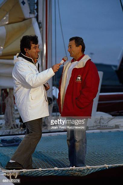 French television host Georges Pernoud with sailing legend Eric Tabarly before the start of the Route du Rhum