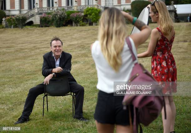 French television host Julien Lepers poses for a photographer during the 21th book fair La Foret Des Livres on August 28 2016 in ChanceauxprèsLoches...