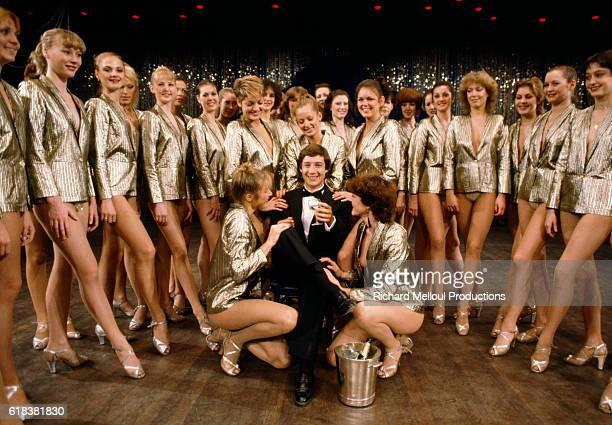 French television host Patrick Sabatier celebrates his 30th birthday with a group of dancers from the Lido de Paris dinner club