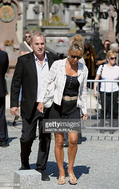 French television host Philippe Risoli and his partner arrive prior to attend the funeral ceremony for French cycling champion Laurent Fignon on...
