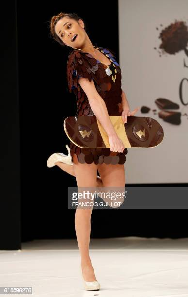 French television hostess Capucine Anav models an creation designed by Cameron Kham and chocolatier JeanPaul Hévin during the 22nd Chocolate Fair...
