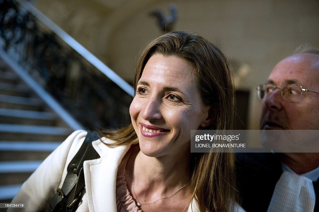 French television journalist Alix Bouilhaguet, one of the two suied French journalists, arrives for her trial, on March 20, 2013 at the Paris' courthouse, after Valerie Trierweiler, the president's 47-year-old partner, suied them for defamation and invasion of privacy, seeking 85,000 euros ($110,000) in damages and court costs, for their book of 'La Frondeuse' (The Rebel). As the trial opened on Monday, it emerged that Hollande sent a letter -- but not on paper with the presidential letterhead -- to the court denying an assertion in the book that he had reached out to the right in the mid-1990s. There was no official reaction from Hollande, but a source close to the president said he was in no way trying to influence the court and was simply providing testimony in the case.