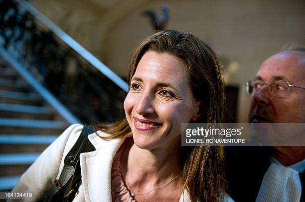 French television journalist Alix Bouilhaguet one of the two suied French journalists arrives for her trial on March 20 2013 at the Paris' courthouse...