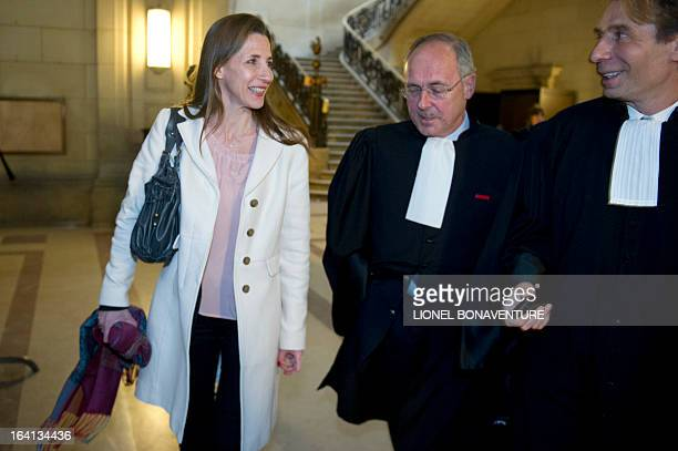 French television journalist Alix Bouilhaguet one of the two suied French journalists wait for the start of her trial with her lawyers on March 20...