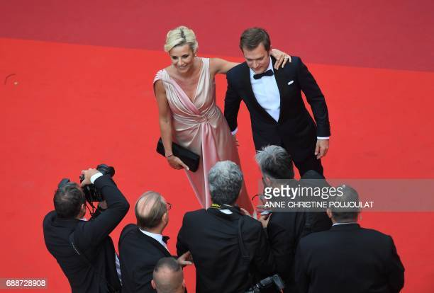 French television journalist Laurence Ferrari and her companion French violinist Renaud Capucon pose as they arrive on May 26 2017 for the screening...