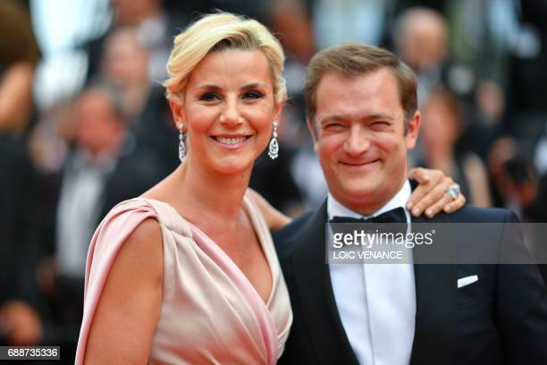 French television journalist Laurence Ferrari and her partner French violinist Renaud Capucon pose as they arrive on May 26 2017 for the screening of...
