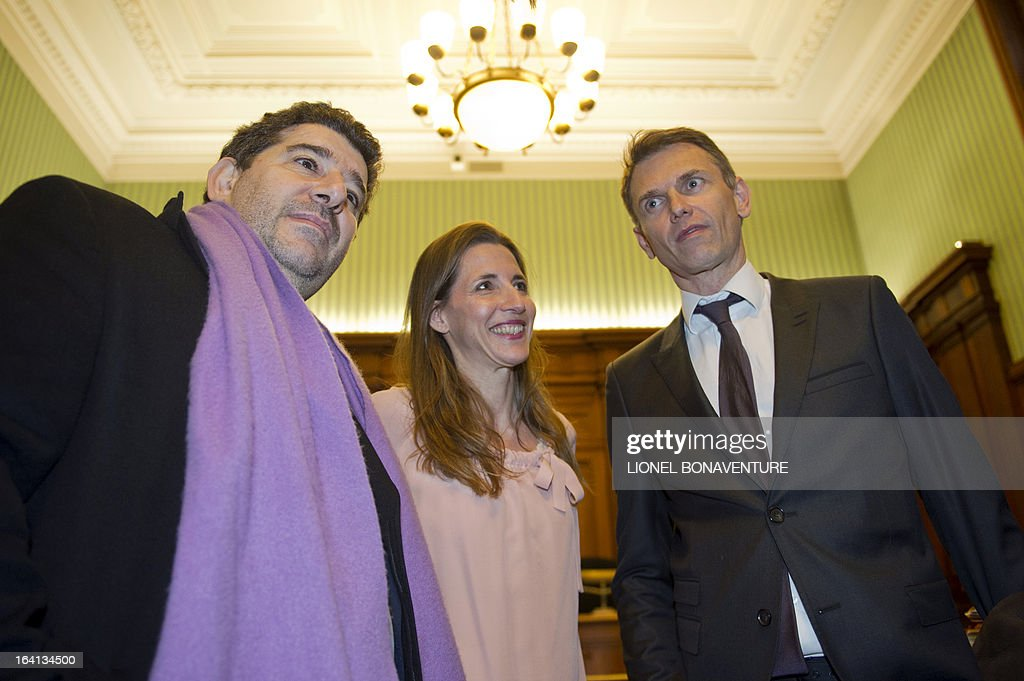 French television journalists Christophe Jakubyszyn (R) and Alix Bouilhaguet (C), and their publisher Yves Derai, director of 'du Moment' publishing house, wait for the start of their trial on March 20, 2013 at the Paris' courthouse, after Valerie Trierweiler, the president's 47-year-old partner, suied them for defamation and invasion of privacy, seeking 85,000 euros ($110,000) in damages and court costs, for their book of 'La Frondeuse' (The Rebel). As the trial opened on Monday, it emerged that Hollande sent a letter -- but not on paper with the presidential letterhead -- to the court denying an assertion in the book that he had reached out to the right in the mid-1990s. There was no official reaction from Hollande, but a source close to the president said he was in no way trying to influence the court and was simply providing testimony in the case. AFP PHOTO / LIONEL BONAVENTURE