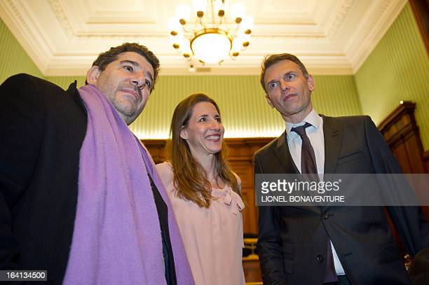 French television journalists Christophe Jakubyszyn and Alix Bouilhaguet and their publisher Yves Derai director of 'du Moment' publishing house wait...