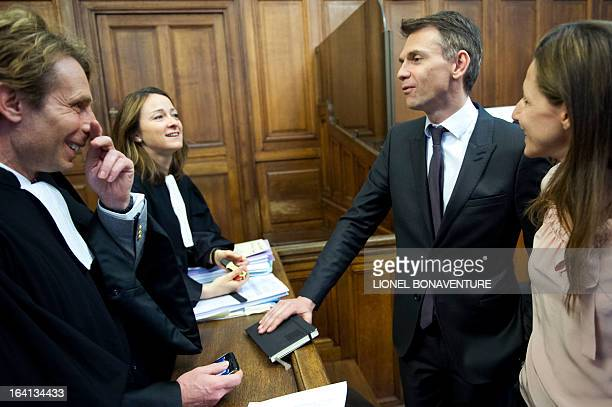 French television journalists Christophe Jakubyszyn and Alix Bouilhaguet speak with their lawyers as they wait for the start of their trial on March...