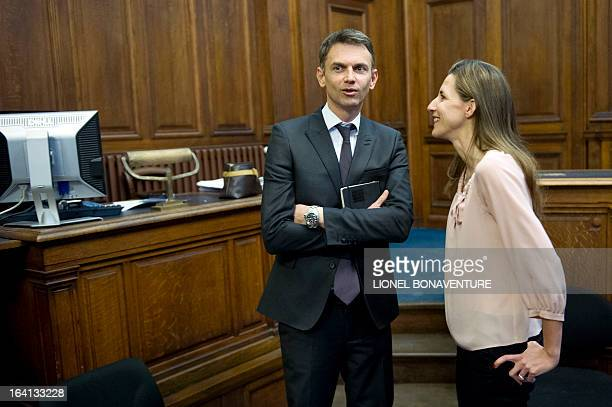 French television journalists Christophe Jakubyszyn and Alix Bouilhaguet wait for the start of their trial on March 20 2013 at the Paris' courthouse...