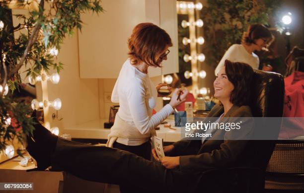 French television presenter Evelyne Thomas shares a laugh with her makeup artist before the broadcast of her TV show C'est mon choix Thomas presents...