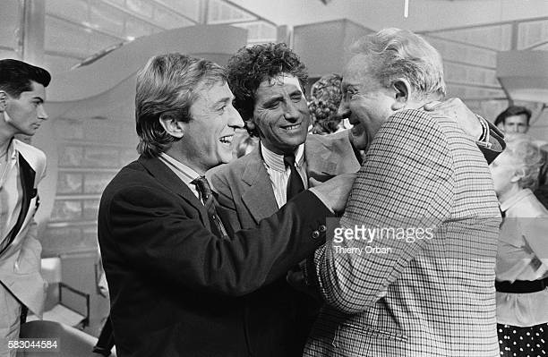 French television presenter Pascal Sevran and French Minister of Culture and Communications Jack Lang greeting singer Charles Trenet on the...