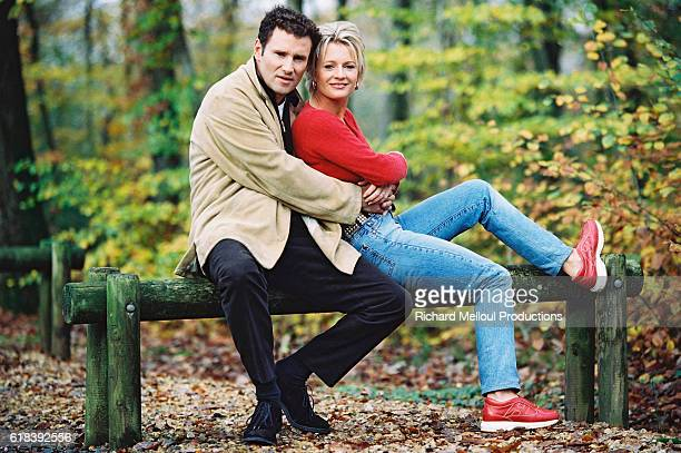 French television presenter Sophie Davant and sports presenter husband Pierre Sled enjoy some spare time in the forests around Normandy