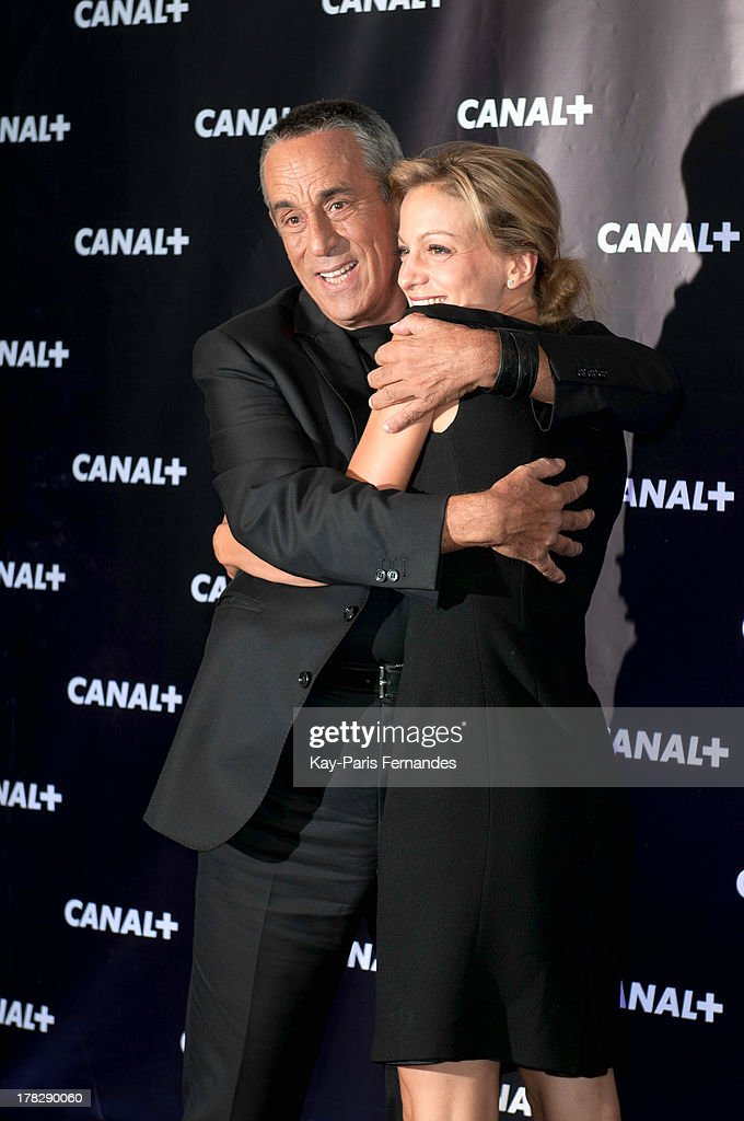 French television producer <a gi-track='captionPersonalityLinkClicked' href=/galleries/search?phrase=Thierry+Ardisson&family=editorial&specificpeople=3156014 ng-click='$event.stopPropagation()'>Thierry Ardisson</a> and Margot Laffite (r) at the 'Rentree De Canal +' photocall at Porte De Versailles on August 28, 2013 in Paris, France.