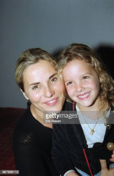 French television show host Sophie Favier attends a Holiday on Ice show with her daughter