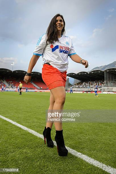 French tennis player and Wimbledon champion Marion Bartoli exits the field wearing a Olympique de Marseille jersey after kicking off the friendly...