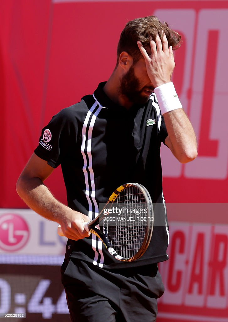 French tennis player Benoit Paire gestures after missing a point against Spanish player Pablo Carreno Busta during their semi-final match of the Estoril Open Tennis tournament in Estoril on April 30, 2016. / AFP / JOSE
