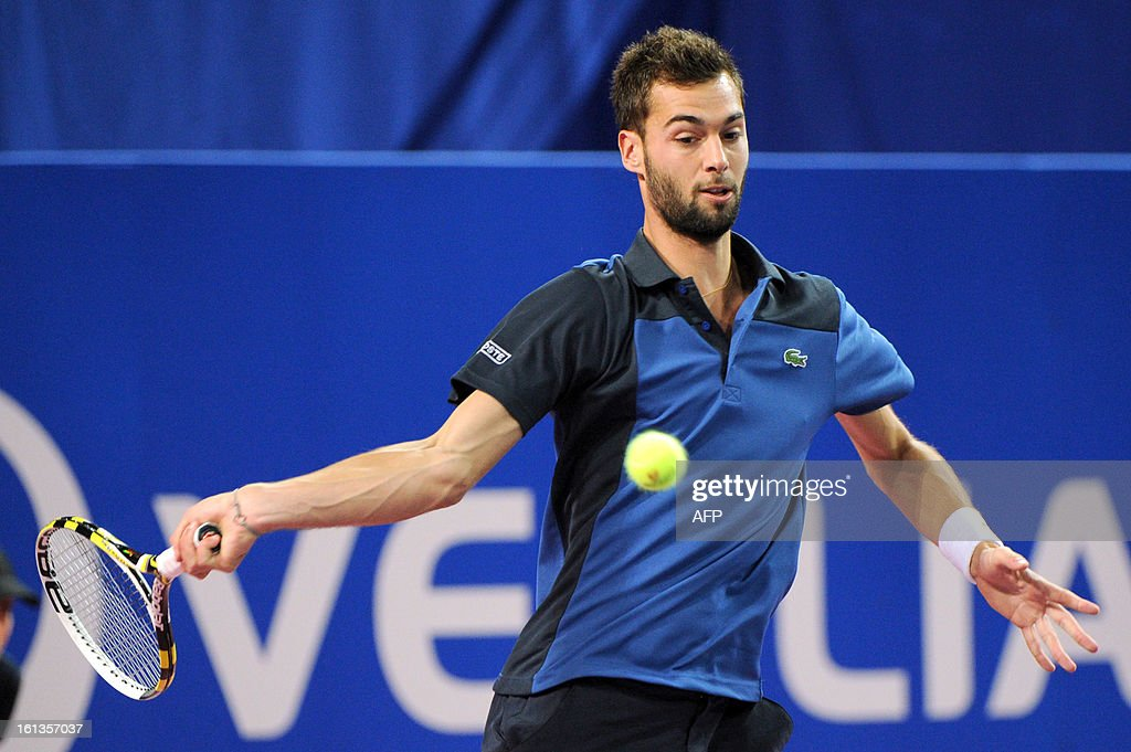 French tennis player Benoit Paire returns the ball to his French opponent Richard Gasquet during the Open Sud de France world tour ATP Series final tennis match, on February 10, 2013 in Montpellier, southern France. Gasquet won 6-2, 6-3. AFP PHOTO / SYLVAIN THOMAS