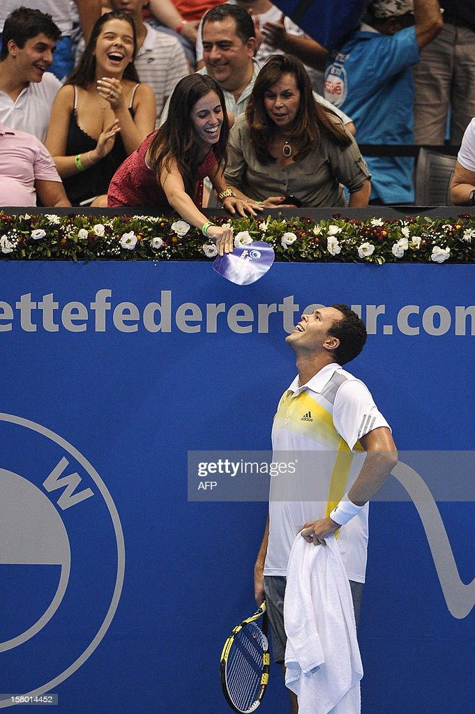 French tennis player French Jo-Wilfried Tsonga rests with spectators during an exhibition match against Swiss Roger Federer held at the Ibirapuera Gymnasium in Sao Paulo, Brazil, on December 8, 2012. AFP PHOTO/Yasuyoshi CHIBA
