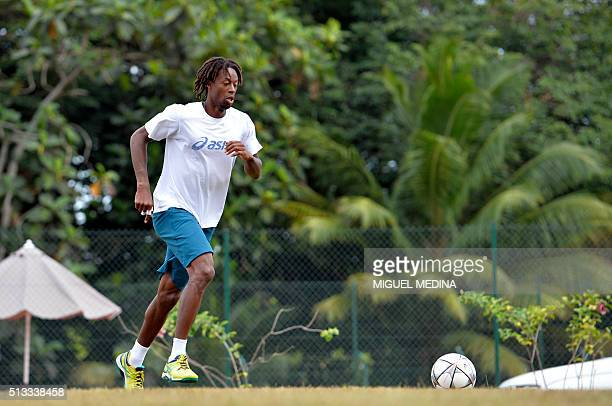 French tennis player Gael Monfils plays football during a training session on March 2 at the Velodrome stade in BaieMahault Guadeloupe ahead of the...