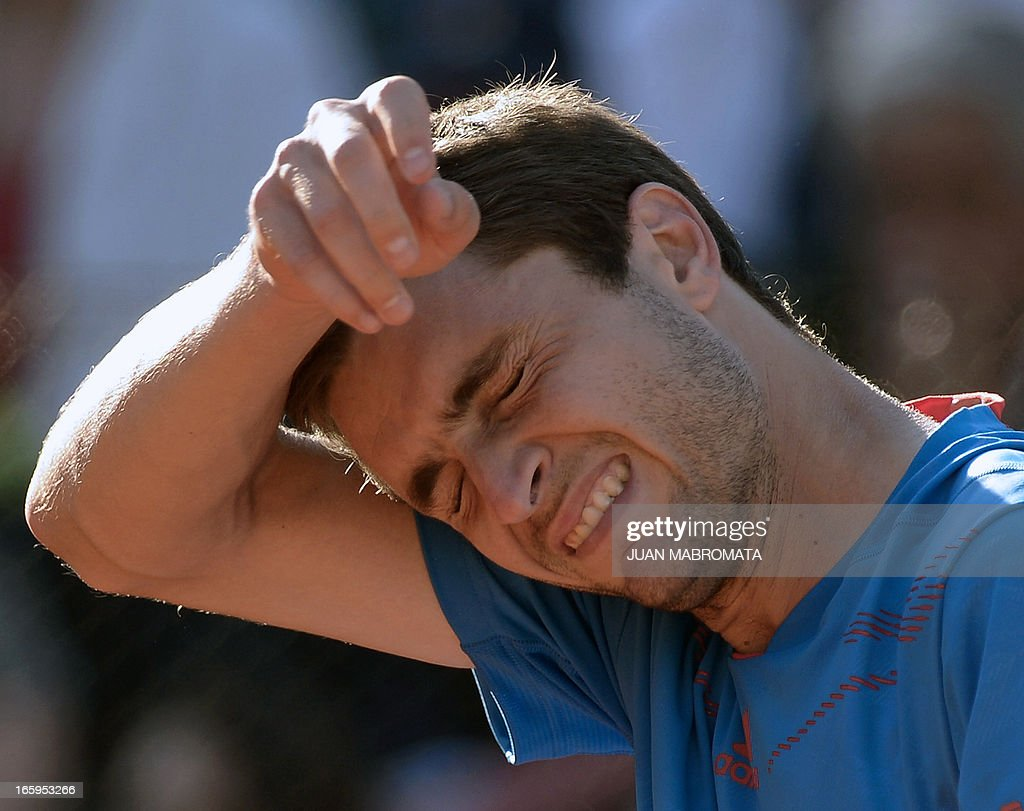 French tennis player Gilles Simon gestures after being defeated by Argentine tennis player Carlos Berlocq by 6-4, 5-7, 6-4, 6-4 in their 2013 Davis Cup World Group quarterfinal single tennis match at Parque Roca stadium in Buenos Aires on April 7, 2013. Argentina won the series by 3-2 and qualified for semifinals. AFP PHOTO / JUAN MABROMATA