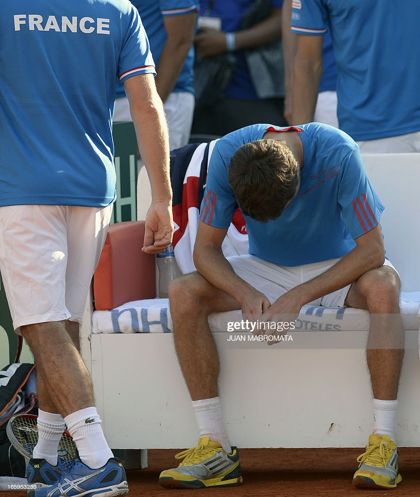French tennis player Gilles Simon reacts in dejection after being defeated by Argentine tennis player Carlos Berlocq by 6-4, 5-7, 6-4, 6-4 in their 2013 Davis Cup World Group quarterfinal single tennis match at Parque Roca stadium in Buenos Aires on April 7, 2013. Argentina won the series by 3-2 and qualified for semifinals.