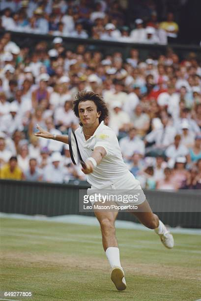 French tennis player Henri Leconte pictured in action competing to reach the semifinals of the Men's Singles tournament at the Wimbledon Lawn Tennis...