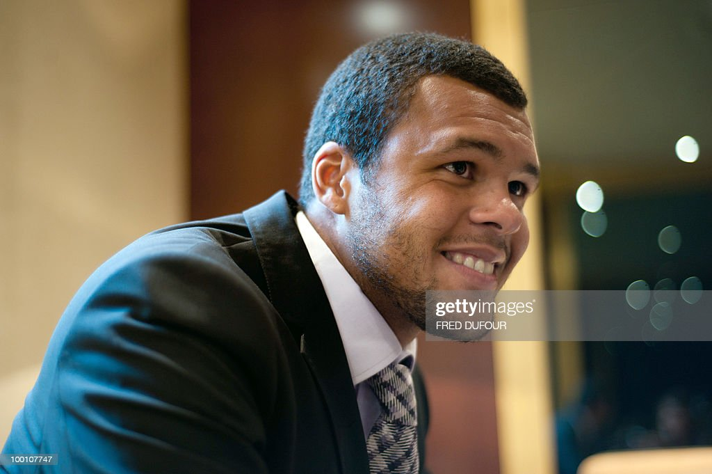 French tennis player Jo-Wilfrid Tsonga answers to a journalist on May 20, 2010, in a Paris hotel prior to a charity auction for Attrap'la balle and Mecenat Chirurgie Cardiaque French associations.