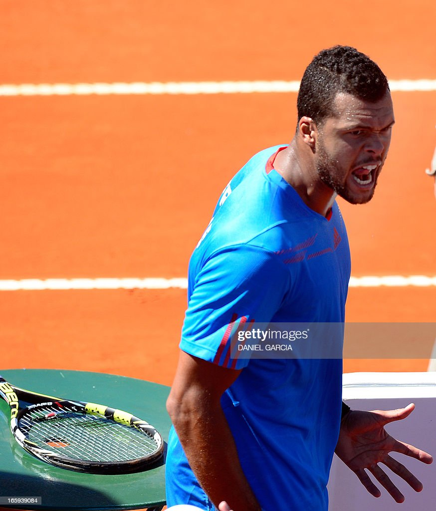French tennis player Jo-Wilfried Tsonga gestures after beating Argentine tennis player Juan Monaco in the Davis Cup quarterfinals tennis match at Mary Teran de Weiss stadium in Roca Park in Buenos Aires on April 7, 2013. Tsonga won 6-3, 6-3, 6-0.
