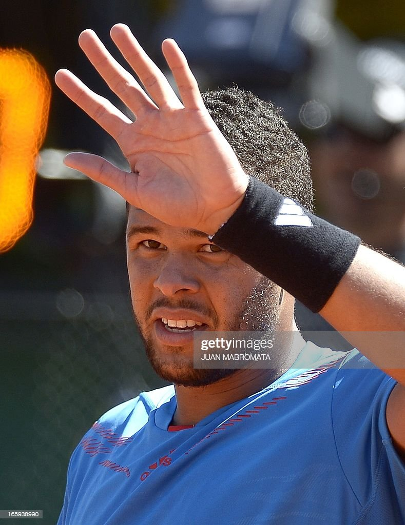 French tennis player Jo-Wilfried Tsonga gestures during the Davis Cup quarterfinals tennis match against Argentine tennis player Juan Monaco at Mary Teran de Weiss stadium in Roca Park in Buenos Aires on April 7, 2013. Tsonga won 6-3, 6-3, 6-0.