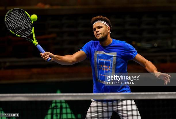French tennis player JoWilfried Tsonga practices during a training session on November 21 2017 at the PierreMauroy stadium in Villeneuve d'Ascq ahead...