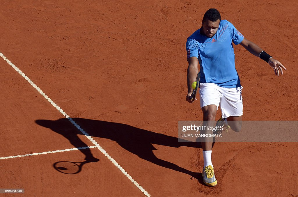French tennis player Jo-Wilfried Tsonga returns the ball to Argentine tennis player Juan Monaco during the Davis Cup quarterfinals tennis match at Mary Teran de Weiss stadium in Roca Park in Buenos Aires on April 7, 2013.