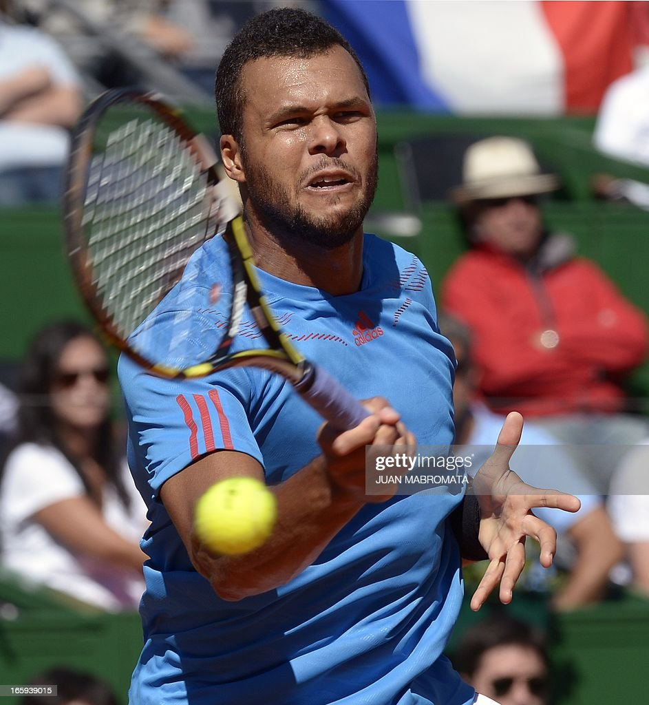 French tennis player Jo-Wilfried Tsonga returns the ball to Argentine tennis player Juan Monaco during the Davis Cup quarterfinals tennis match at Mary Teran de Weiss stadium in Roca Park in Buenos Aires on April 7, 2013. Tsonga won 6-3, 6-3, 6-0. AFP PHOTO / JUAN MABROMATA