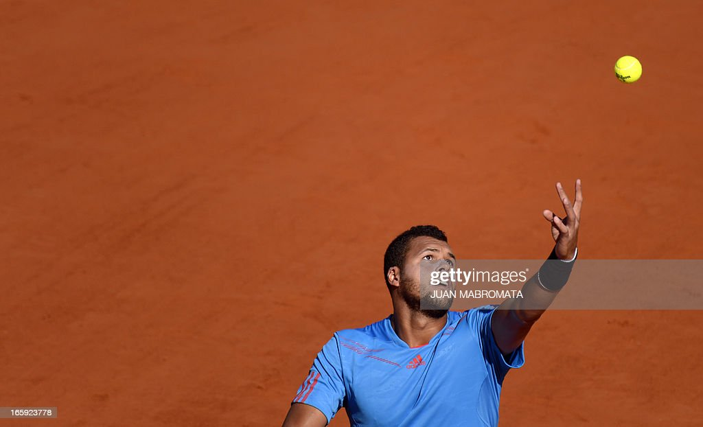 French tennis player Jo-Wilfried Tsonga serves the ball to Argentine tennis player Juan Monaco during the Davis Cup quarterfinals tennis match at Mary Teran de Weiss stadium in Roca Park in Buenos Aires on April 7, 2013.