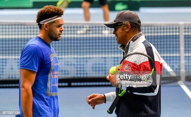 French tennis player JoWilfried Tsonga talks with France's team captain Yannick Noah during a training session on November 21 2017 at the...