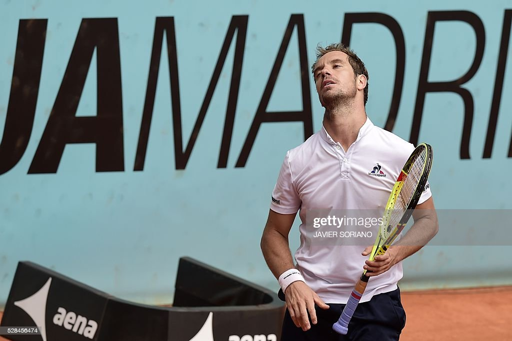 French tennis player Richard Gasquet gestures during his match against Japanese tennis player Kei Nishikori during the Madrid Open tournament at the Caja Magica (Magic Box) sports complex in Madrid on May 5, 2016. / AFP / JAVIER
