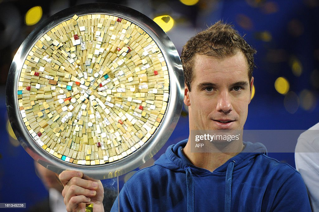French tennis player Richard Gasquet poses with his trophy after winning over France's opponent Benoit Paire at the end of the Open Sud de France world tour ATP Series final tennis match, on February 10, 2013 in Montpellier, southern France. Gasquet won 6-2, 6-3.