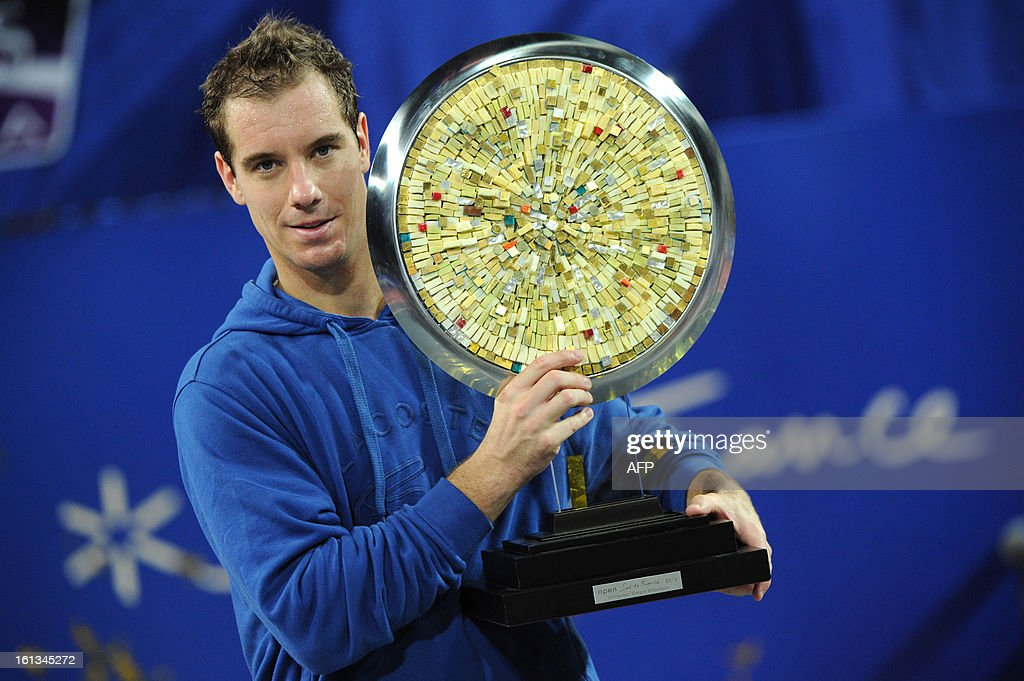 French tennis player Richard Gasquet poses with his trophy after winning over France's opponent Benoit Paire at the end of the Open Sud de France world tour ATP Series final tennis match, on February 10, 2013 in Montpellier, southern France. Gasquet won 6-2, 6-3. AFP PHOTO / SYLVAIN THOMAS