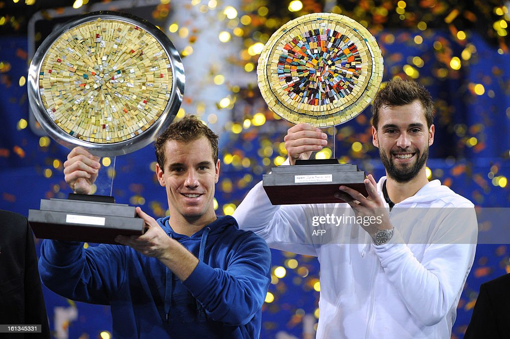 French tennis player Richard Gasquet (L) poses with his trophy after winning over France's opponent Benoit Paire (R) at the end of the Open Sud de France world tour ATP Series final tennis match, on February 10, 2013 in Montpellier, southern France. Gasquet won 6-2, 6-3.