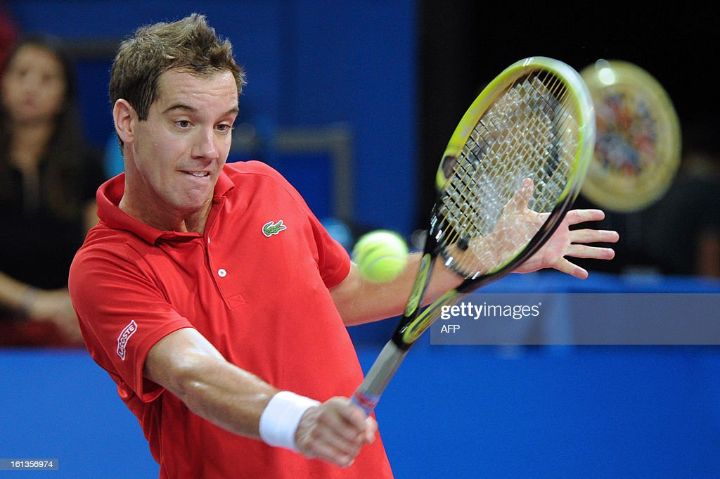 French tennis player Richard Gasquet returns the ball to his French opponent Benoit Paire during the Open Sud de France world tour ATP Series final tennis match, on February 10, 2013 in Montpellier, southern France. Gasquet won 6-2, 6-3.