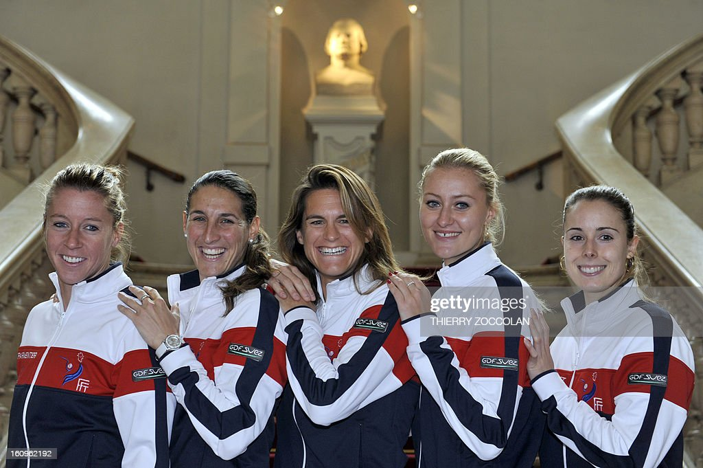 French tennis players (from L) Pauline Parmentier, Virginie Razzano, team captain Amelie Mauresmo, Kristina Mladenovic and Alize Cornet pose on February 8, 2013 prior to the draw for the Fed Cup World Group first round match against Germany held at Limoges' Town Hall.