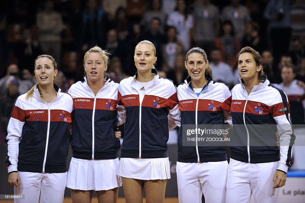 French tennis team players (From L) Alize Cornet, Pauline Parmentier, Kristina Mladenovic and Virginie Razzano pose flanked by their coach Amelie Mauresmo (R) prior to a Fed Cup 2013 tennis match France vs Germany on February 10, 2013 at the Beaublanc courts in Limoges. Germany completed a 3-0 win over France in a Fed Cup World Group II tie today when Julia Goerges defeated Pauline Parmentier 6-4, 6-2.